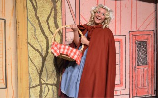 Becca Nowak as Little Red Riding Hood.