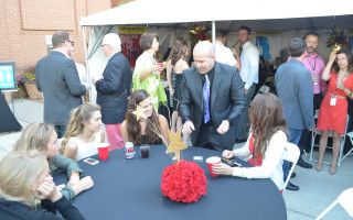 Stuart MacDonald performs a magic trick for a table of Great Big Night patrons at 2014's event. This year's Great Big Night is June 12.